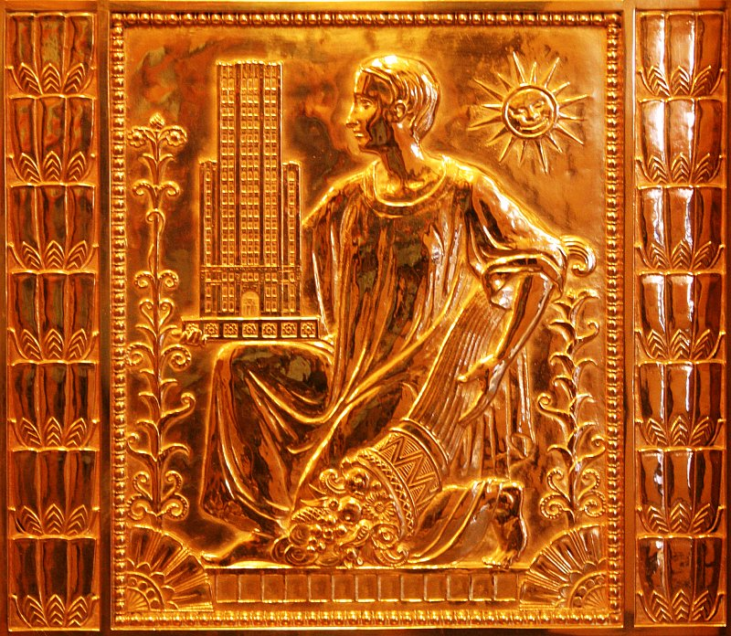 Brass elevator door with sun    (click for previous picture)