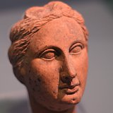 Teracotta woman, possibly a muse, with a 'melon' coiffure common in the Hellenistic period - 275-250 BCE